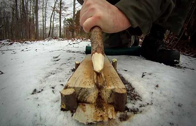 making a fire with wood
